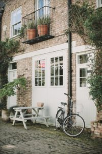 house with table and bicycle - mjs property investments